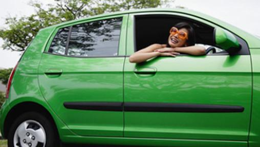 girl smiling in green car